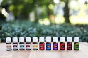 a line of Young Living Essential Oils on an outdoor background