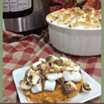 Instant Pot Sweet Potato Casserole: The Fervent Mama - The sweetness of the potato, saltiness of the walnuts, the melty-ness of the marshmallows. I'm drooling over this Instant Pot Sweet Potato Casserole right now. #InstantPotHolidayMeals #PressureCookerChristmasRecipes