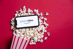 Amazon Prime video logo on a smartphone with popcorn