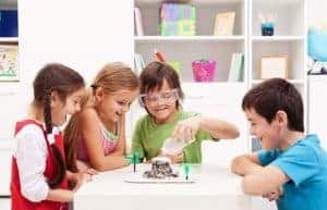 Kids repeating and observing a science lab project at home - the baking soda and vinegar volcano