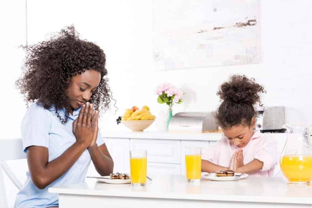 mom and daughter praying together