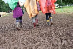 Wellies walking through festival mud