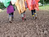 Wellies walking through festival mud