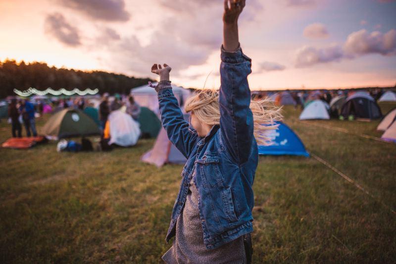 Girl in festival campsite