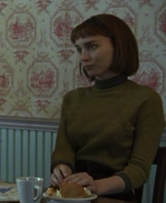 Therese wears a ribbed mock-turtleneck sweater in similar hues throughout the film.
