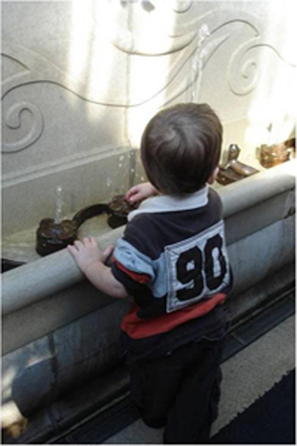 toddler playing with fountain on Lower Ramp. Image courtesy Carol A. Krawczyk, ASLA.