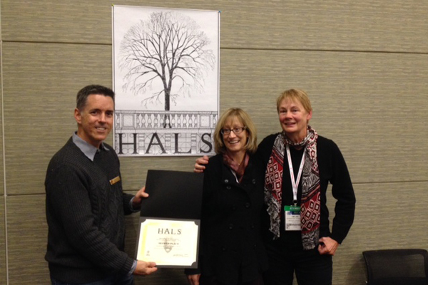 2nd Place Photo. Chris Stevens, ASLA and HALS Landscape Architect, presents the 2nd Place certificate to Gina Chorover and Helen Erickson, on behalf of their The Arizona Inn HALS AZ-9 HALS short format historical report. Chorover and Erickson also represented Jennifer Levstik, who was not present. image: Deborah Steinberg