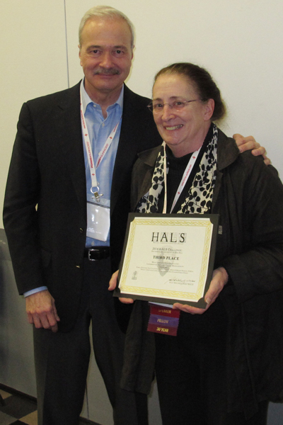 Third place winner Marion Pressley accepting the award from Paul Dolinsky, Chief of HALS. image: Chris Stevens