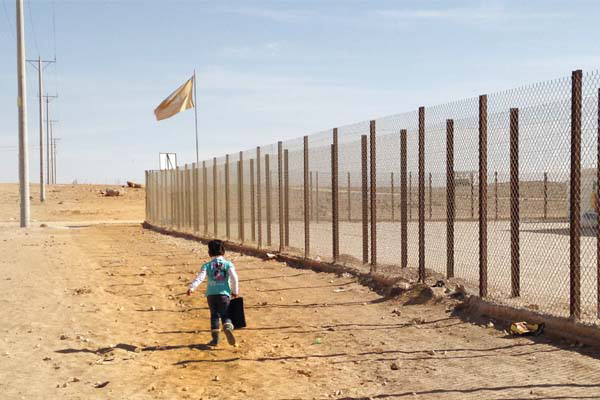 A young girl walking to school in the Al-Za'atari refugee camp, January 2014  image: Malda Takieddine
