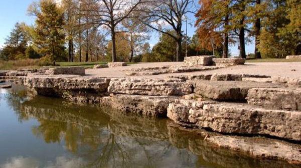 Slab/Stones Creating a Natural Border Along Edge of Pond image: Chris Miracle