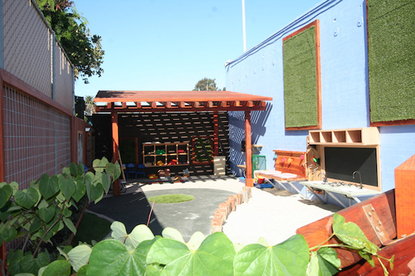 After. View Looking North at the shade structure. The new trellis structure lets in dappled sun as well as airflow, creating a much more comfortable outdoor classroom space than the previous shade tent. image: Ty Sterns