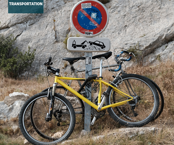 Bicycles locked to road sign