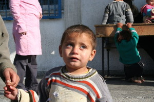 A Palestinian boy at the Fakhoura school where dozens were killed by an Israeli strike cries. The boy like hundreds of others, were seeking refuge at the school. This occured in 2009, making him a likely candidate for recruitment, if he is still alive. Photo: Al Jazeera English