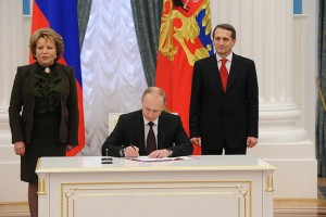 """Ceremony signing the laws on admitting Crimea and Sevastopol to the Russian Federation 1"" by Kremlin.ru. Licensed under CC BY 3.0 via Wikimedia Commons - http://commons.wikimedia.org/wiki/File:Ceremony_signing_the_laws_on_admitting_Crimea_and_Sevastopol_to_the_Russian_Federation_1.jpg"