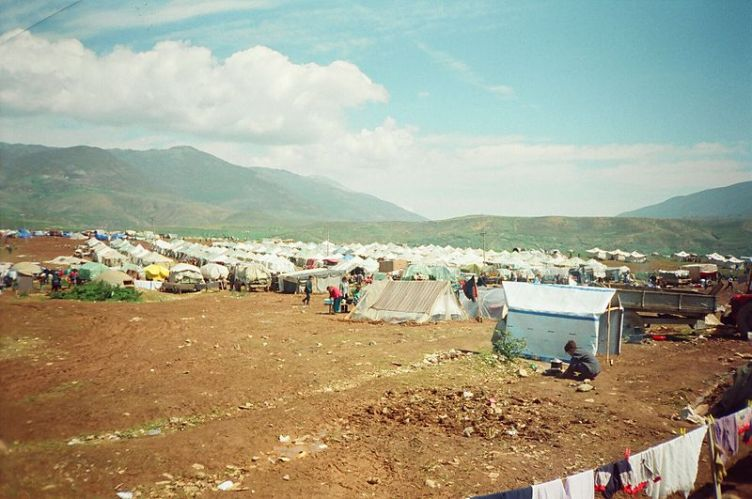 "Refugee camps outside of Kosovo. Yugoslavia was a resort destination before the war. ""Kampi i Kosovareve gjate Eksodit 99"" by Jonuz Kola"