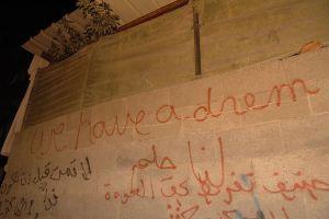 """Graffiti in Palestine """"English-Arabic graffiti in Palestine""""."""