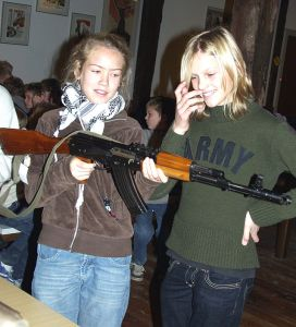 "Two Danish children handle an AK-47. ""Skoletjeneste 2"" by SFHM"