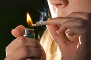 Smoking Marijuana. Image Source: Chuck Grimmett, Flickr, Creative Commons