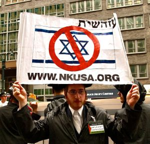 "Israel and Palestine. Image Source: ""Neturei Karta protest"" by aprilzosia from Brooklyn, USA -"