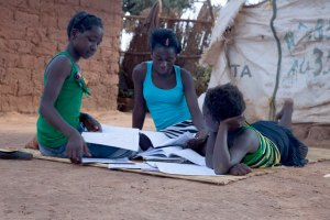 Girls doing homework outside. Image Source: Francesco Volpi, Flickr, Creative Commons