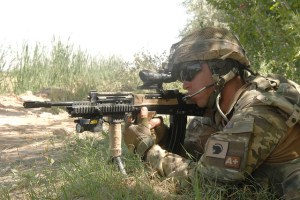 A soldier from 1LANCS observes through the ACOG sight of his L85A2 rifle during a contact with the insurgents. Soldiers serving with the Combined Force Nad-e Ali Battlegroup have been involved in a dramatic push south into insurgent held territory to move Taliban fighters away from the population centres of the southern Nad-e-Ali district and establish new patrol bases. Units from the 1st Battalion The Duke of Lancaster's Regiment, The Royal Dragoon Guards,  The Queens Royal Lancers, The First Battalion the Royal Regiment of Scotland, 21 Engineer Regiment, the Combined IED Taskforce, and Joint Helicopter Force, along with Afghan security forces took part in the operation.