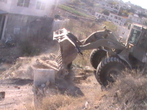 Israeli bulldozer. Image Source: Palestine Solidarity Project, Flickr, Creative Commons