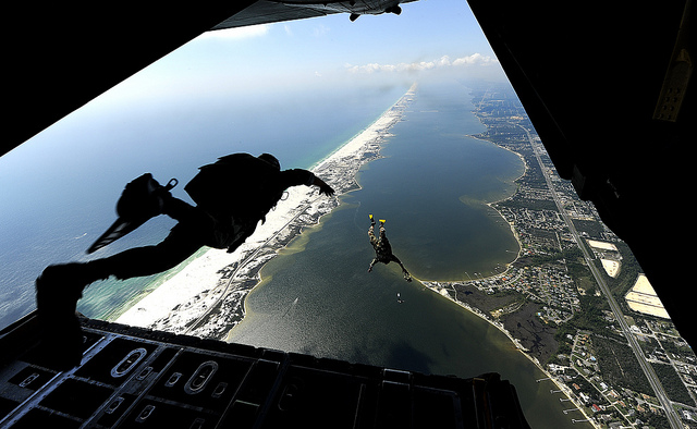 U.S. Air Force members from the 23rd Special Tactics Squadron, Air Force Special Operations Command, Hurlburt Field, Fla., jump out of the back of a C-130 Hercules Sept. 27, 2010. The airmen will practice combat operations in the Santa Rosa Sound. (U.S. Air Force Photo by Master Sgt. Russell E Cooley IV/Released)