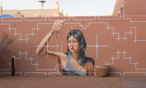 Image Source: Jay Galvin, Flickr, Creative Commons Native Woman Dropping Sand from Hand, Mural Museum of Contemporary Native Arts, IAIA