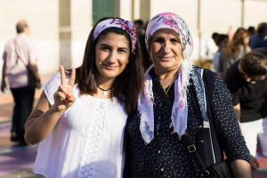 "Image Source: Marius Haffner, Flickr, Creative Commons Generations for Peace Daughter and mother posing for peace in Kurdistan. We met the two during a peace-demo in Bern. All over Switzerland kurds united to ask for peace in the kurdish territories and to demostrate against the turkish strikes. It was a very peacful demo. People stopted and watched, others gathered together to talk. We searched for subjects to photograph but hesitated since it's kind of weird for me as a shy swiss to ""intrude"" into others privacy. I finally did, as you may see. Our two models are daughter and mother. They too came to Bern to demonstrated and they quickly agreed to pose for us. My girfriend talked to them while I took the pictrues. It was a pretty quick action and they seemed sattisfied with the result. We exchaned some info (where to find the photo) and went on. After this quick shooting it seemed way easier to talk to completly strangers and ask them to pose for us. After all it was a very fascinating afternoon."