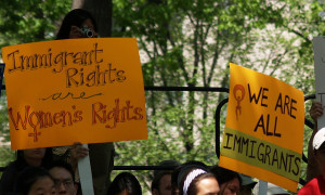 """Image Source: takomabibelot, Flickr, Creative Commons """"Immigration Rights Are Women's Rights"""" & """"We Are All Immigrants"""" Signs At The May Day Immigration Rights Rally (Washington, DC)"""