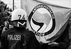 Image Source: Gregor Fischer, Flickr, Creative Commons antifa  a policeman against the antifa at a demonstration of right-wing groups