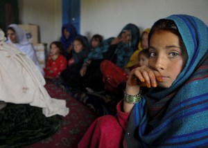 An Afghan girl attends a female engagement team meeting in Balish Kalay Village, Urgun District, Afghanistan, March 27. Women and children attended the meeting with the FET of Paktika Provincial Reconstruction Team to discuss major issues and concerns. The FET gathers vital information from Paktika women, and uses that information to help improve their economic, educational and health issues. For the FET, this meeting was a rare opportunity to learn more about the women of Afghanistan. Image Source: DVIDSHUB, Flickr, Creative Commons