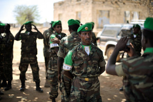 Image Source: AMISOM Public Information, Flickr, Creative Commons 2014_01_22_Ethiopia_Welcome_Ceremony_012.jpg An Ethiopian soldier has his photo taken wearing an African Union beret after a ceremony in Baidoa, Somalia, marking the inclusion of Ethiopia into the African Union peace keeping mission on January 22. AU UN IST PHOTO / Tobin Jones