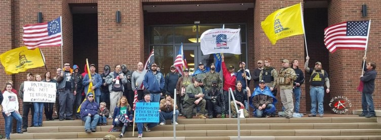 This photo was taken with the intention of it being sent Finicum's family with the flag and a letter.