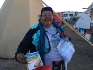 Winona, the remarkable woman who is feeding the protectors 3 meals a day - Photo Credit - Debra Cohen