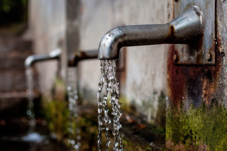 water flowing from outdoor tap