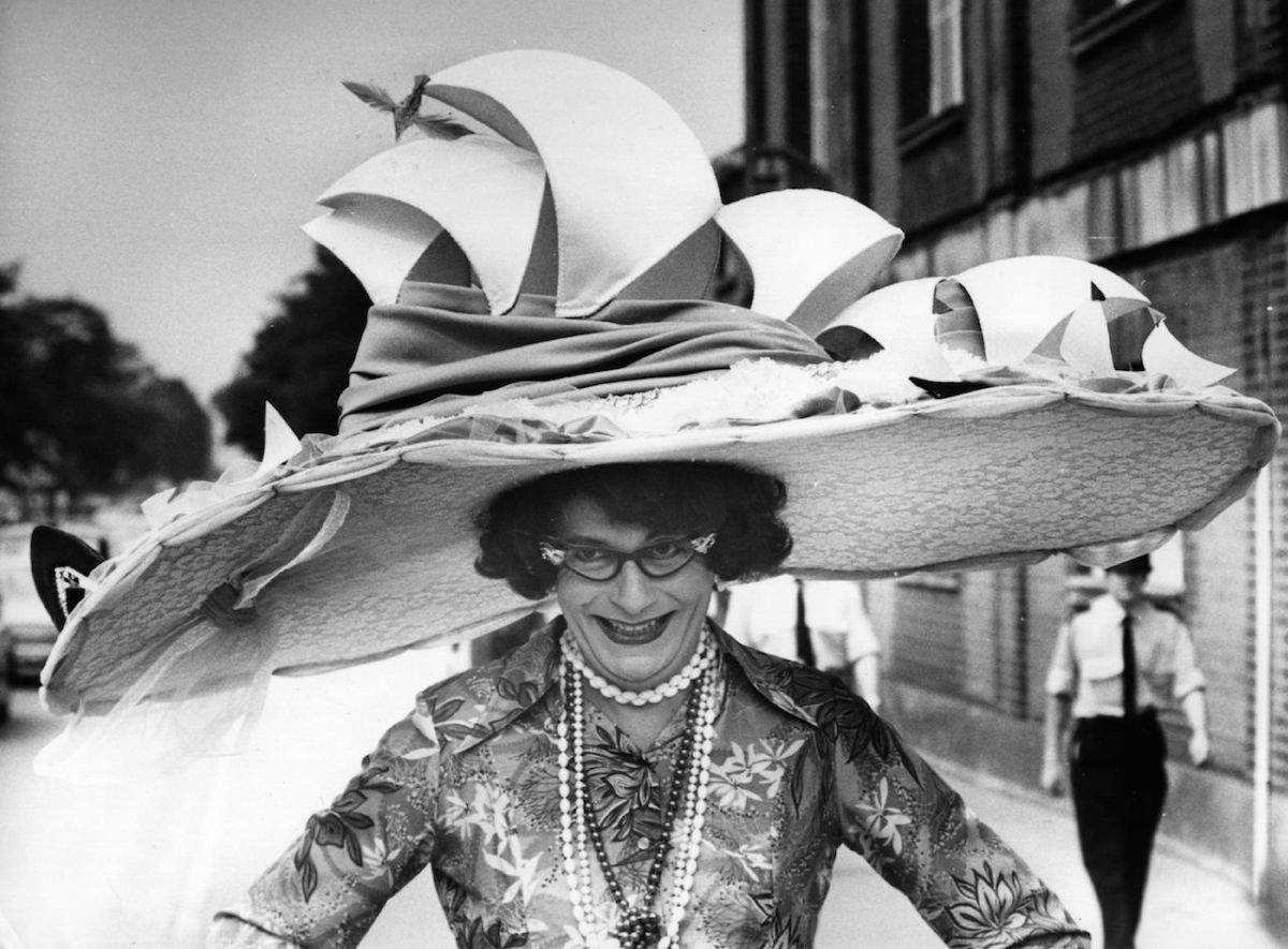 Dame Edna Everage — a character created by Australian comedian Barry Humphries — models a hat based on the Sydney Opera House. She is currently performingDame Edna's Glorious Goodbye: The Farewell Tour.