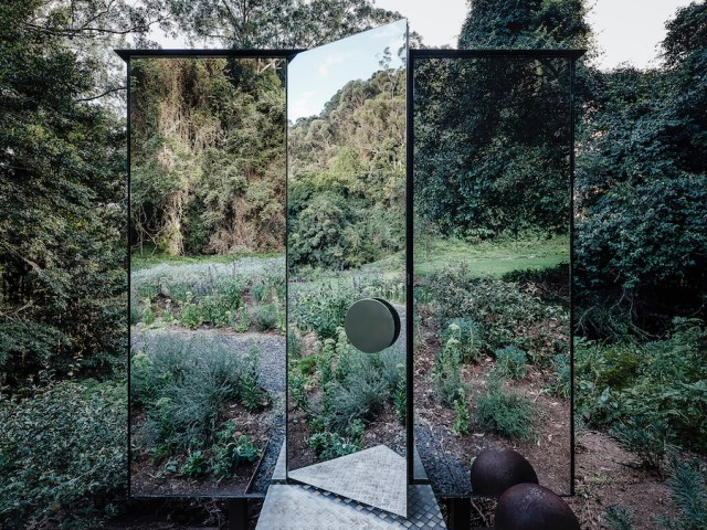 Photograph of the mirrored outhouse