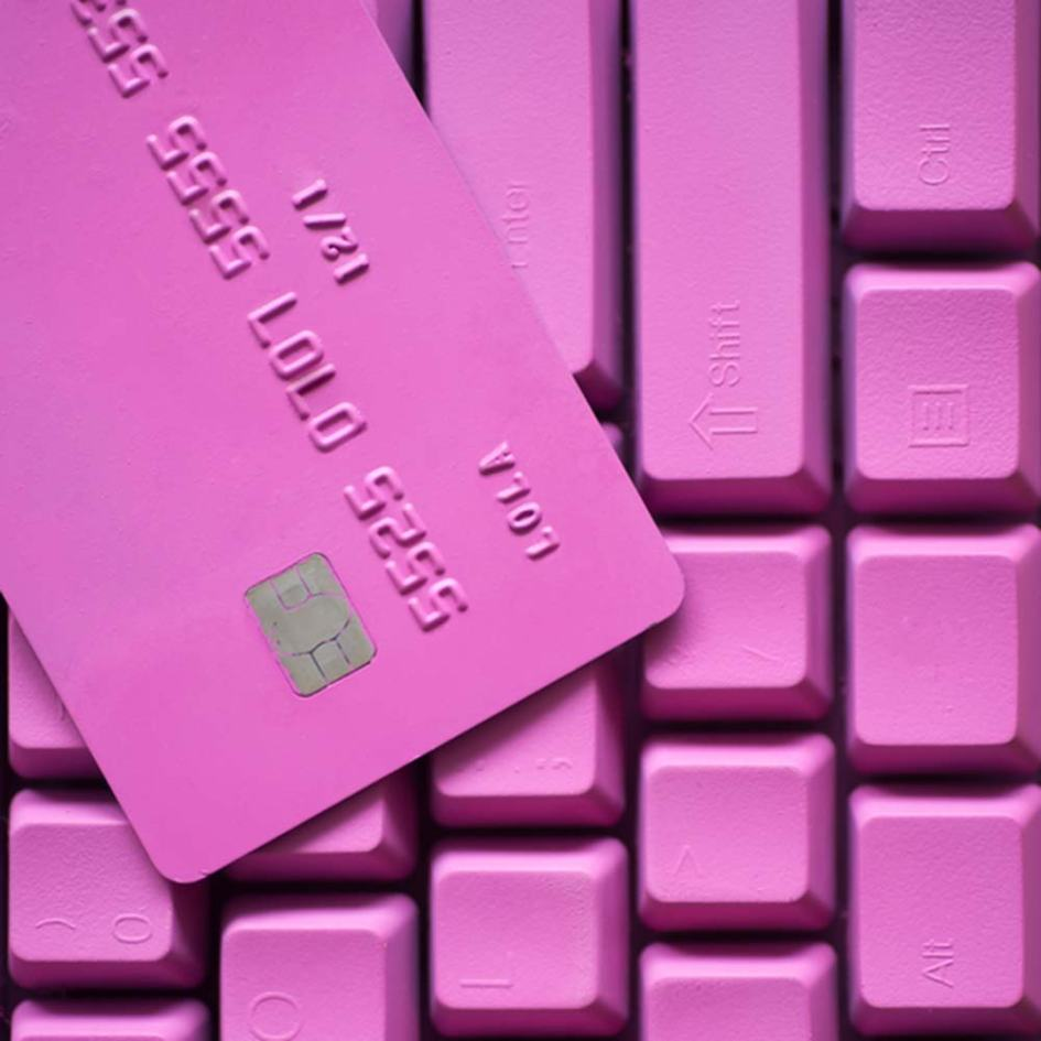 a pink keyboard and credit card