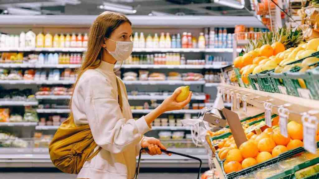 millennial shopping for food to help her finances amid covid19
