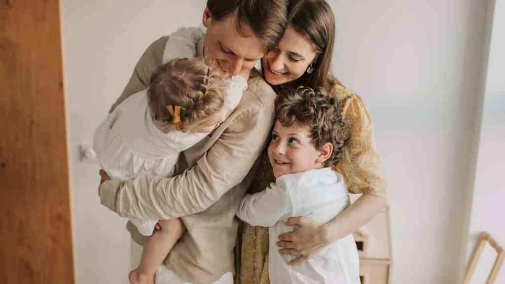 a happy family with kids hoping to avoid financial mistakes