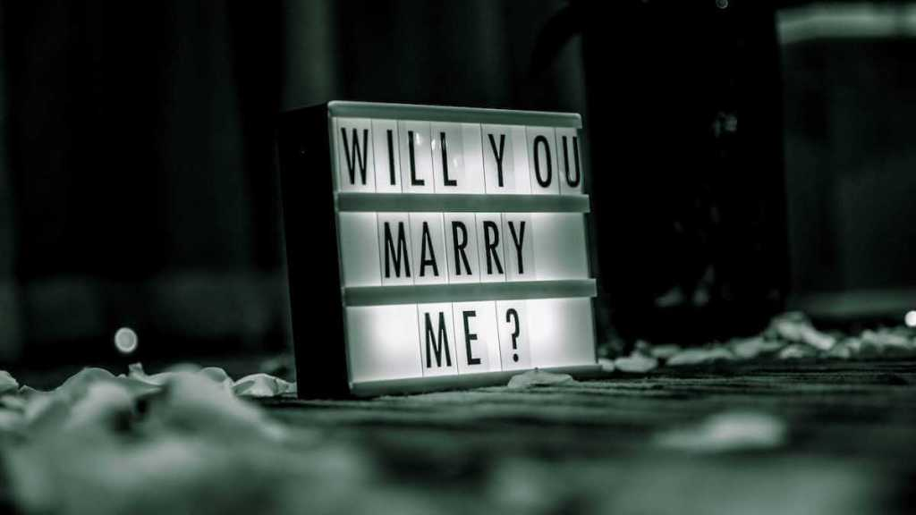 a will you marry me sign that makes a Romantic Wedding Proposal Idea At Home