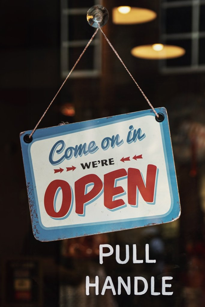 An open sign from a small shop