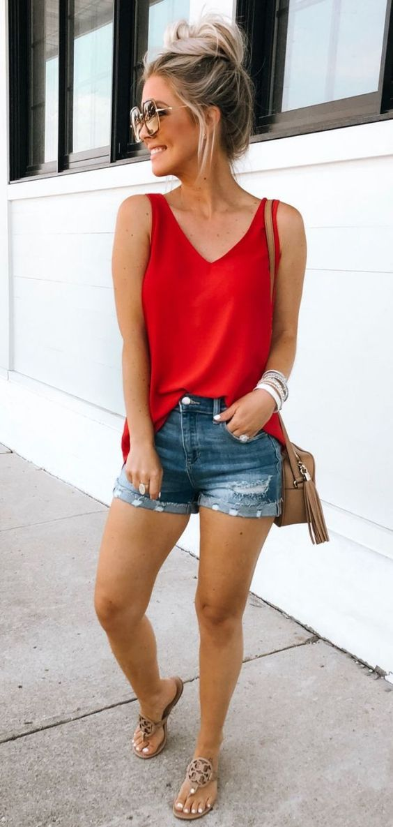 Red camisole and denim shorts. Casual Womens Fashion and Womens Cool Trending Clothes, Dresses. #womensfashion #womensdress #summeroutfit #casualoutfit