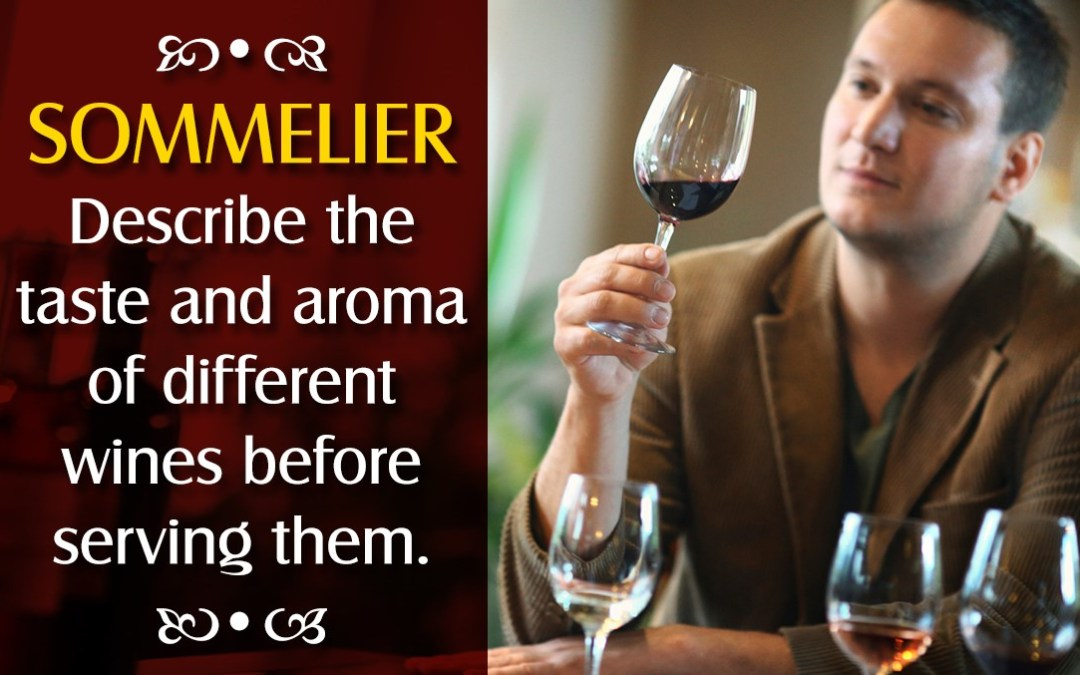 A Sommelier holding a glass of wine