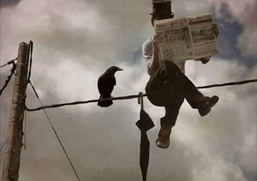 Writing prompt: Businessman seated on a telephone wire. Watched by a crow.