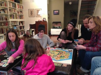 Playing a board game after a long day of site-seeing.