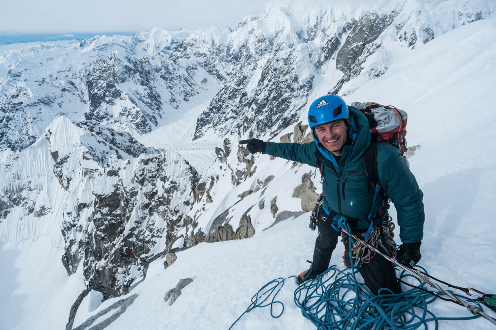 Roskelley pointing at the complete south ridge from the summit of Idiot Peak on day five. He and Helander would summit that night. (Photo: Clint Helander)