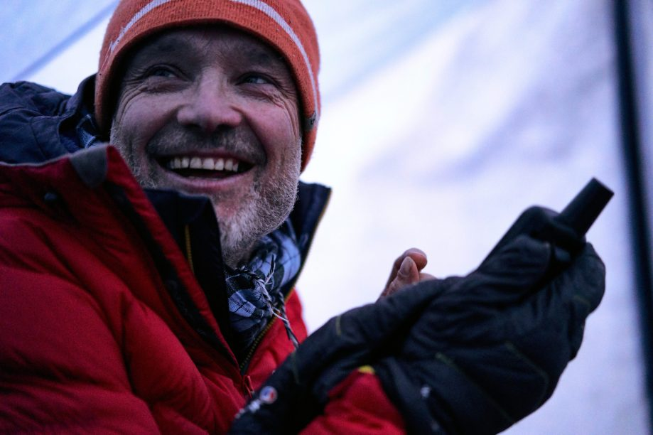 Malcolm gets a good weather forecast on the Inreach at Janhukot base camp 2018. Photo: Hamish Frost
