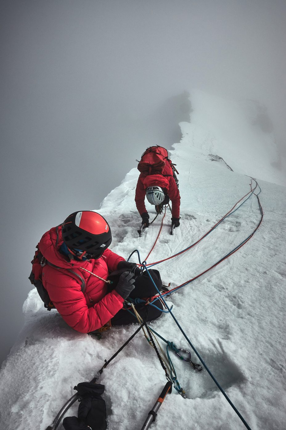 Malcolm prioritising photography over rope work as Paul reaches the summit of Janhukot. Photo: Guy Buckingham